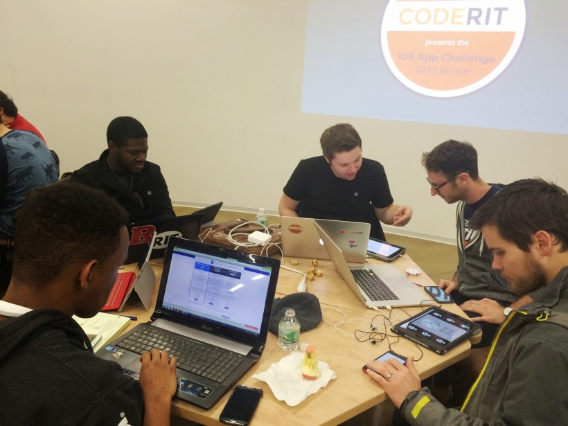 Us working with an Apple Engineer during the hackathon.