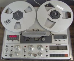 Look at all the buttons and knobs on the analog reel to reel audio recorder.
